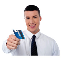 A man reaching out a debit card (Links to Hicksville Debit and ATM card page.)
